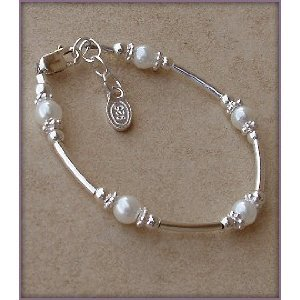 Madelyn Sterling Silver Childrens Girls Bracelet Jewelry This unique sterling silver bracelet is made with silver curved tubes and beautiful white Czech pearls accented by sparkling silver daisies on either side - a dainty and delicate touch! Size Medium 1-5 Years (5-5.5