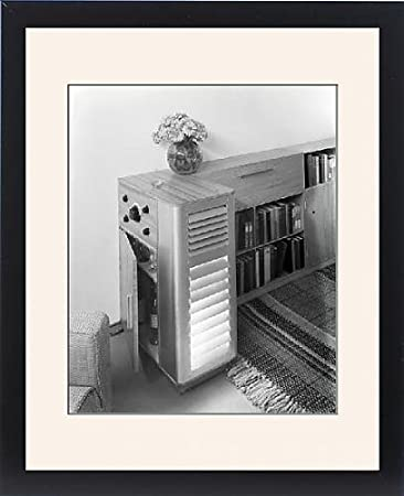 Framed Print of Combined bookcase and drinks cabinet at an exhibition