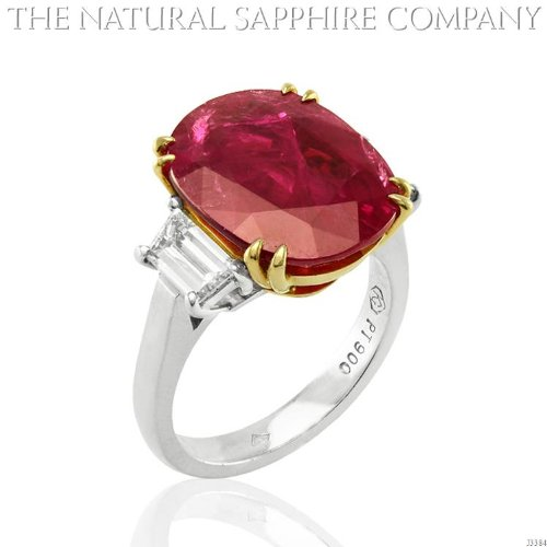 9.23ct Natural Round Ruby set in a Platinum and 18k Gold Mounting with .86cts of diamonds