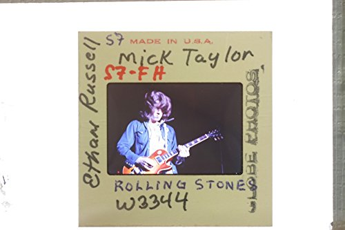 slides-photo-of-mick-taylor-performing-with-the-rolling-stones
