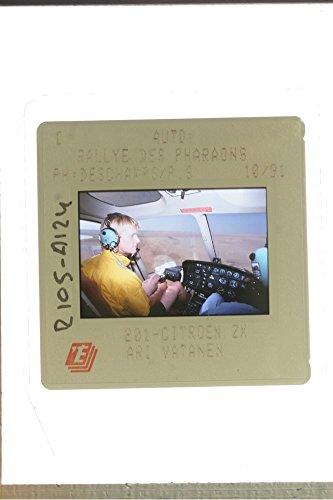 slides-photo-of-ari-vatanen-driving-a-plane