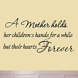 a mother holds her children 39 s hands for a