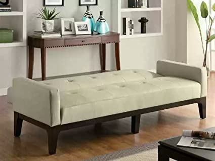 Cream colored leather like vinyl upholstered folding sofa bed with tufted back and seat with espresso finish wood frame