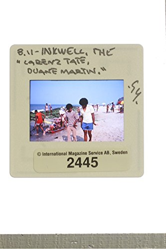 slides-photo-of-american-actor-larenz-tate-and-actor-duane-martin-walking-together-beside-the-beach-