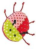 Kaethe Kruse grabbing toy Beetle