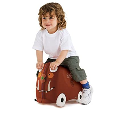 Boy riding on Trunki Gruffalo suitcase for kids