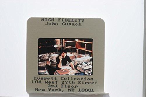 slides-photo-of-john-cusack-as-rob-gordon-in-his-record-store-from-the-scene-of-high-fidelity