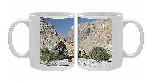 photo-mug-of-gravel-road-along-the-floor-of-deep-wadi-below-limestone-cliffs-wadi-bani-habib