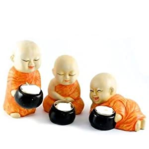 Buy karigaari orange white buddha monks candle holders for Small home decor items