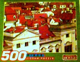 According to Hoyle Red Rooftops 500 Piece Puzzle Made in the USA