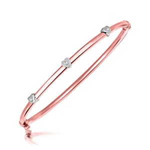 Sterling Silver Rose Tone Diamond Heart Motif Station Bangle (.03 ct. t.w.)