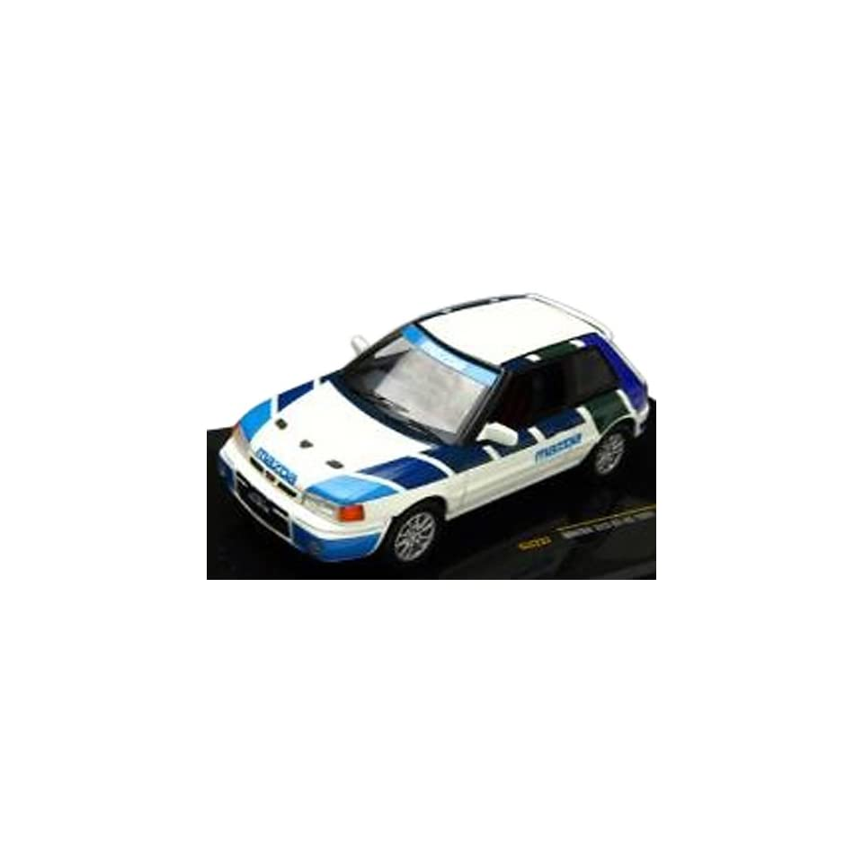 Ixo 1/43 Scale Prefinished Fully Detailed Diecast Model, 1991 Mazda 323 GT AE Coupe Street Car with Right Hand Drive in white with trim pattern in light blue, dark blue, dark green and purple #CLC237