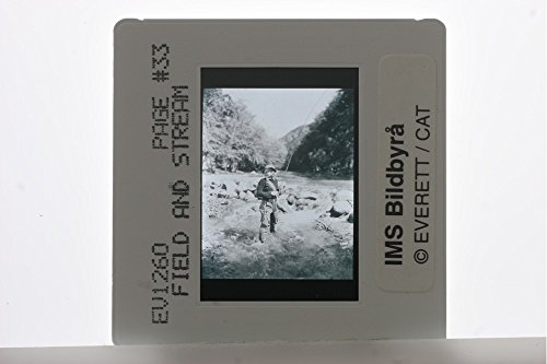 slides-photo-of-a-woman-fishing-in-the-field-stream