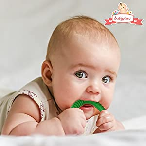 BEST Baby Teether Toy - Set of 4 Colours - Sold with Lifetime Guarantee - Made from Food Grade Silicone - Certified BPA Free - Each Teether is 6.5x13cm Diameter - Weight:16g - Fully Dishwasher & Freezer Safe - 4 Colours: Blue, Green, Yellow, Pink - Help develop your baby's sensory & play skills. FREE e-book with each order for a limited time - In Stock and Ships for FREE with Amazon.Com