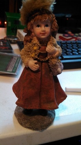 White girl with a red's coat and hat on holding a teddy bear - 1