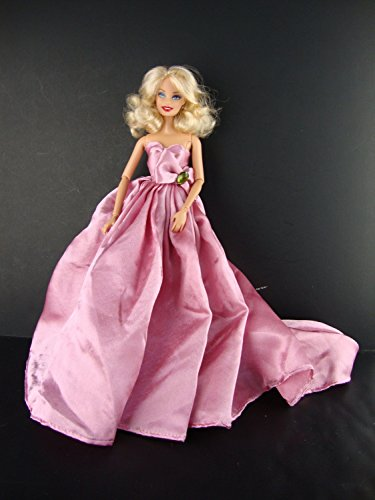 A Long Flowing Gown in Pink with a Large Train Made to Fit the Barbie Doll