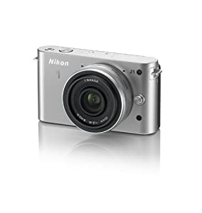 Nikon 1 J1 Systemkamera (10 Megapixel, 7,5 cm (3 Zoll) Display) silber inkl. 1 NIKKOR 10 mm Pancake Objektiv