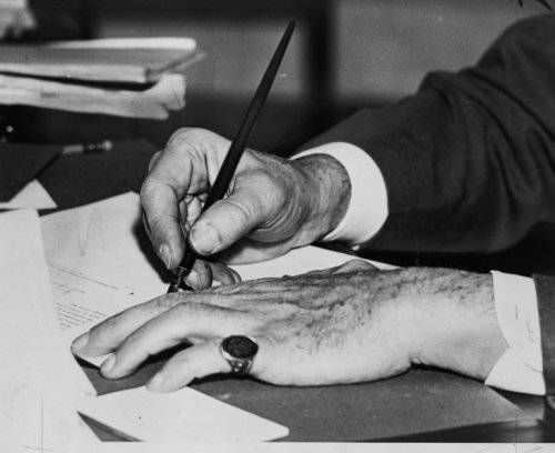 1934 photo Hands in the new deal graphic. Photograph shows the hands of Franklin D. Roosevelt signin