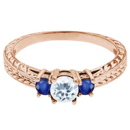 0.59 Ct Round Sky Blue Topaz Blue Sapphire 18K Rose Gold 3-Stone Ring