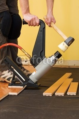 "Wallmonkeys Peel and Stick Wall Decals - Man Installing Tongue and Groove Hardwood Floor. - 48""H x 32""W Removable Graphic"