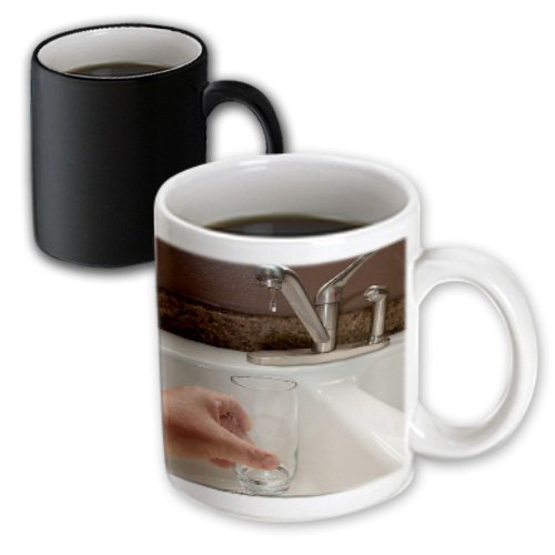 Mug_50517_3 Jos Fauxtographee Conceptual - A Hand Holding A Clear Glass Up To The Faucet And A Drop Of Water Ready To Drip Into It - Mugs - 11Oz Magic Transforming Mug