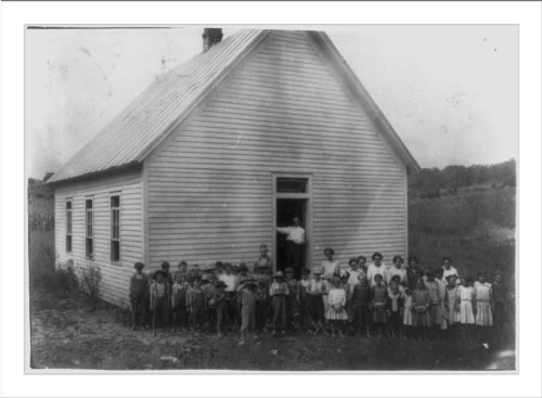 Historic Print (L): Red Bud School. County Supervisor in doorway. Teacher thought 20 absent on account of wo
