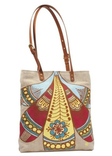 The Amy Butler Harper Tote features adjustable leather handles, linen exterior, aged brass buckle hardware, interior pockets, and lined with cotton prints from the Breeze collection.
