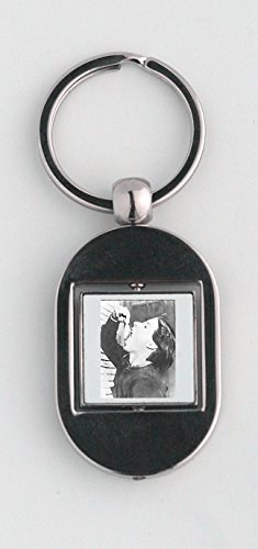 Key ring with Woman eating fish open wide mouth.