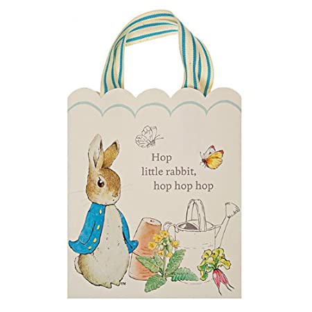 These wonderful party bags feature the deliciously naughty Peter Rabbit and the classic words of Beatrix Potter: Hop little rabbit hop hop hop. They are decorated with woven ribbon and come in a natural finish presentation box. Box contains 8 party b...