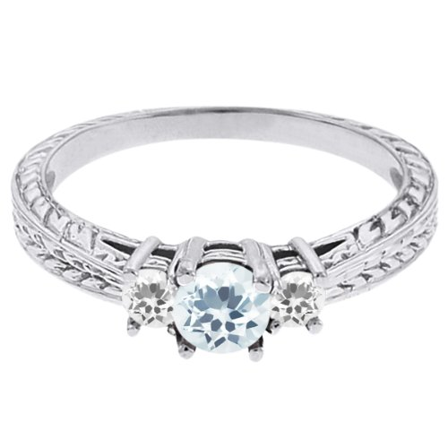 0.59 Ct Round Sky Blue Topaz White Sapphire 18K White Gold 3-Stone Ring