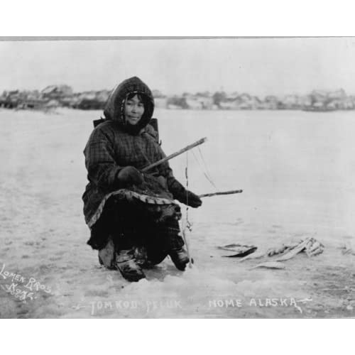 Eskimo fishing in ice Tom Kod Peluk, Nome, Alaska photo