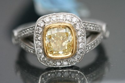 2.18 CT FANCY YELLOW CUSHION CUT DIAMOND ENGAGEMENT RING WITH ACCENTS VS-2 PLATINUM
