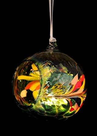 Friendship Hanging Night Light in Shades of Green. Introducing a range of glass Friendship Gifts by the Milford Collection including Friendship Globes, Friendship Night Lights, Friendship Hanging Night Lights, Friendship Candleholders and Friendship Hearts. Each piece is hand blown and made from recycled glass. Colours may vary as each one is unique. The colours are stunning and capture the light perfectly in daylight and by candle light. Traditionally given as tokens of love and friendship on special occasions, our range of Friendship gifts make perfect presents for Christmas, Valentine's Day, Mother's Day and Easter.