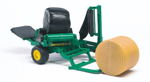 Bale wrapper with yellow and black round bales