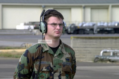 Photo Staff Sergeant Eric Daniels, Usaf, Crewchief, 437Th Aircraft Generation Squadron, Charleston Afb, South Carolina, Wearing David Clark H10-30 Headset, Prepares To Marshal Out An Aircraft Embarking On Another Mission In Support Of Operation Enduring F