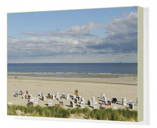 canvas-print-of-beach-with-chair-beach-north-sea-with-a-cloudy-sky-spiekeroog-east-frisia
