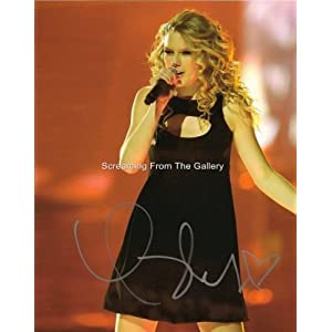 Taylor Swift Autograph on Com  Taylor Swift Hand Signed 8x10 On Stage Stunning Autographed