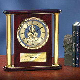 Large Da Vinci Dial Round Brass Gold Clock Suspended in Cherry Wood with Gold Engraving Plate. This desk clock is a great executive gift, retirement gift or anniversary gift.