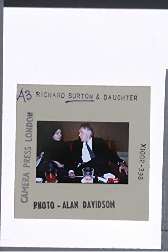 slides-photo-of-richard-burton-and-daughter-liza-todd-burton-sitting-at-the-table-and-talking-to-eac