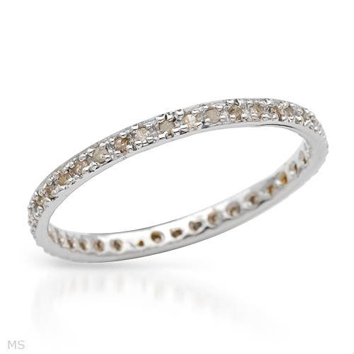 White Gold 0.2 CTW Accent Diamond Eternity Ladies Ring. Ring Size 7. Total Item weight 1.0 g.