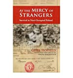 img - for At the Mercy of Strangers: Survival in Nazi Occupied Poland (Holocaust Memoirs) (Paperback) - Common book / textbook / text book