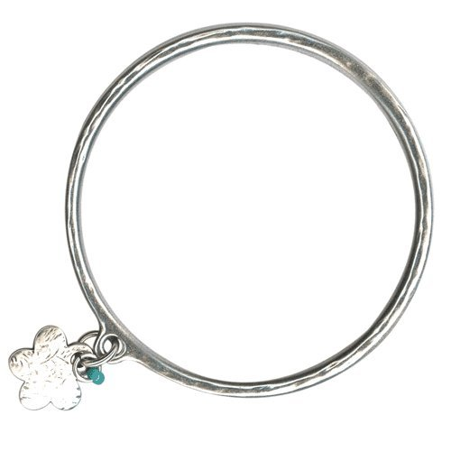 silver bangle with a small flower charm and turquoise gemstone