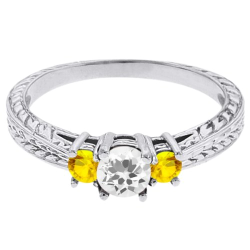 0.59 Ct Round White Topaz Yellow Sapphire 18K White Gold 3-Stone Ring