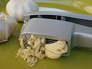 Garlic Press and Slicer in One! Cleaning Tool Included! By Vitaville, the Bistro Line Collection people rave about.