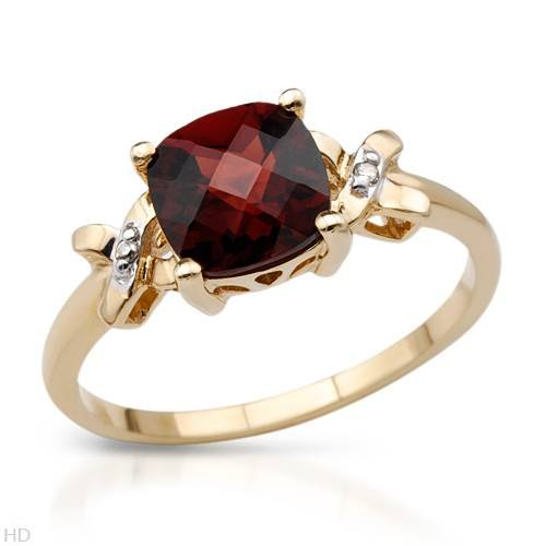 Yellow Gold 2.24 CTW Garnet and 0.01 CTW Accent Diamond Ladies Ring. Ring Size 7. Total Item weight 2.1 g.