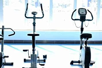 Stationary Bicycle in a Gym Center. - Peel and Stick Wall Decal by Wallmonkeys