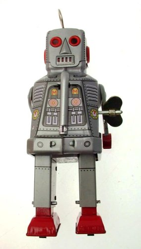 Collectors silver colour tin clockwork walking robot with sparking eyes and mouth