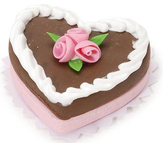 Darice Timeless MinisTM Miniature Heart Chocolate Cake. 1.25 inches. 1 piece per Package. Heart Chocolate Frosted Cake with White Icing Trim and Pink Roses. Place this Cake into any Doll House Kitchen, Scene, Display, or Shadow Box to Celebrate a Special Occasion!