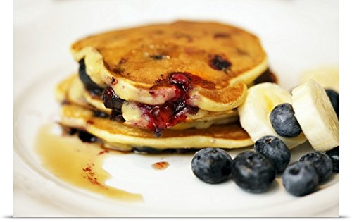 Pancakes with blueberries, bananas and maple syrup