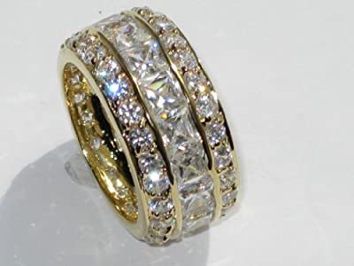High End Designer Eternity Ring With Princess Cut 4x4MM Swarovski Element Crystals Surrounded By Brilliant Round Crystals. Best Selling Eye Catching Ring